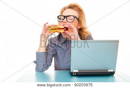 Hungry Girl Eating Sandwich On Work, Isolatd On White. Studio Shot