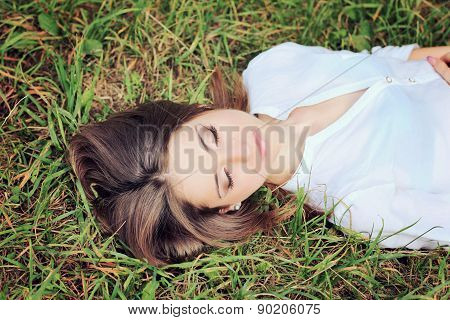 beautiful girl with dark hair eyes closed