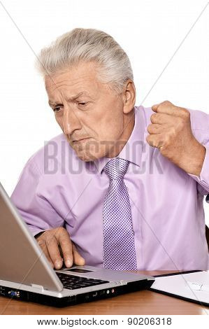 Old businessman working with notebook