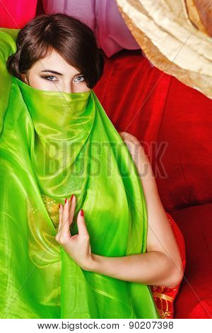 Oriental Beauty Covers Her Face With A Shawl