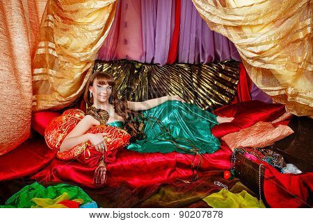 Oriental Beauty Is In Tent On Pillows