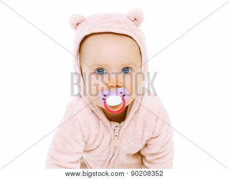 Closeup Portrait Of Sweet Baby With Pacifier On A White Background