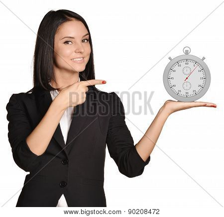 Office girl standing on white background and holding stopwatch