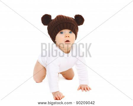 Portrait Of Cute Baby In Knitted Hat Crawls