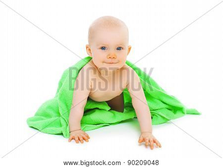 Portrait Of Cute Baby With A Towel After Bathing