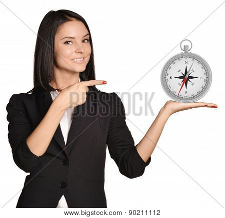 Office girl standing on white background and holding compass