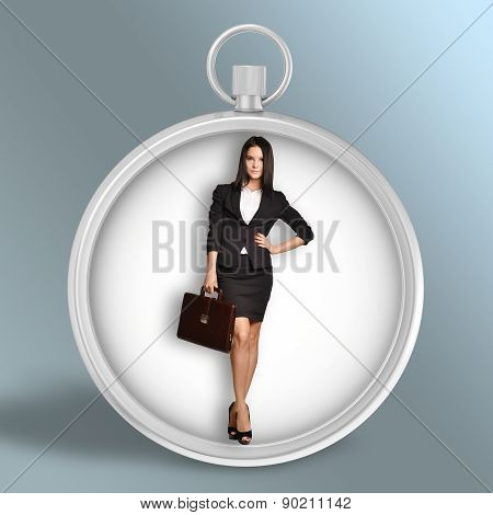 Woman with leather briefcase standing in blank stopwatch