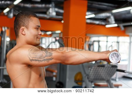 Profile of man holding dumbbells in front chest