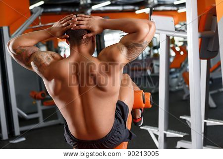 Back view of man doing abdominal crunches
