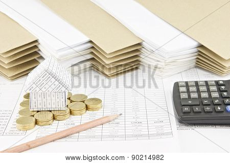 House On Pile Of Gold Coins As Triangle With Pencil