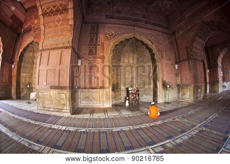 NEW DELHI, INDIA - JUNE 4, 2012: man praying in the mosque Jama Masjid in Delhi