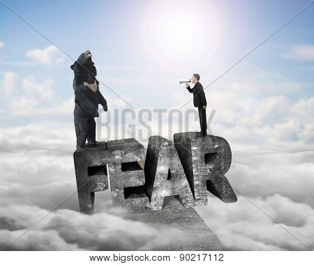 Businessman Yelling Bear At 3D Fear Word With Sunlight Cloudscape