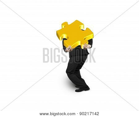 Businessman Carrying 3D Gold Jigsaw Puzzle Piece Isolated On White