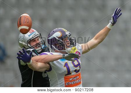 INNSBRUCK, AUSTRIA - MAY 3, 2014: DB Arno Andreas (#8 Raiders) and Stefan Postel (#19 Vikings) fight for the ball.