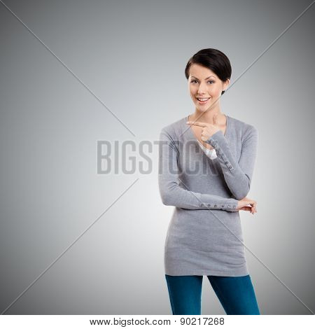 Pointing finger gesture, isolated on grey