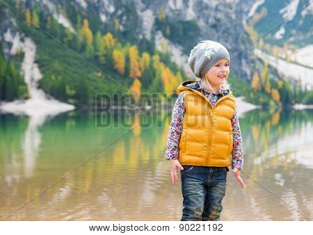Smiling Girl On The Shore Of Lake Bries