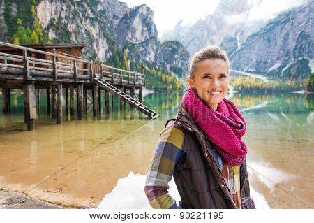 Woman At Lake Bries With Wooden Pier In The Background