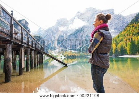 Woman At Lake Bries Standing Looking At Wooden Pier