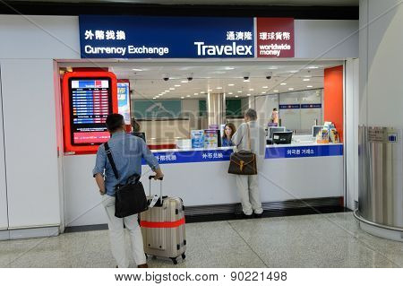 HONG KONG - MAY 06, 2015: Travelex counter in airport. Travelex Group is the world's largest foreign exchange bureau and is a major donor and sponsor of the Royal National Theatre.