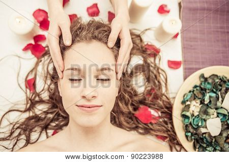 Head Massage. Young Woman Making Massage In The Spa