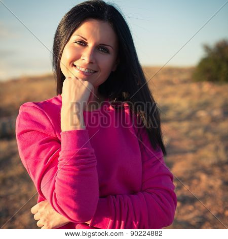 Woman Enjoying Freedom And Life On Beautiful And Magical Sunset
