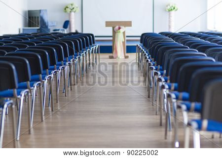 Line Of Chairs In The Empty Auditorium Arranged In Two Sections