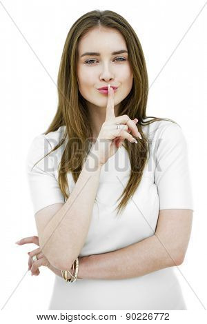 Portrait of attractive teenage girl with finger on lips, isolated over white background concept of student show quiet, silence, secret gesture, young pretty brunette woman