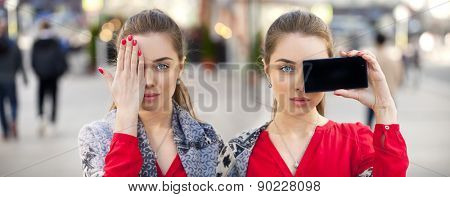 Collage, two Young beautiful women closes her eyes with his hand on a background of the street