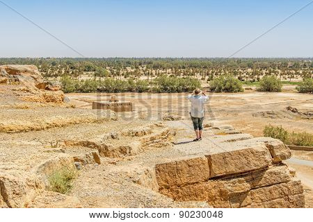 Tafilalt oasis in Morocco - senior tourist looks the landscape from Tinrheras ksar