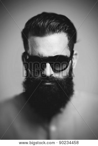 Portrait of brutal hipster wearing sunglasses