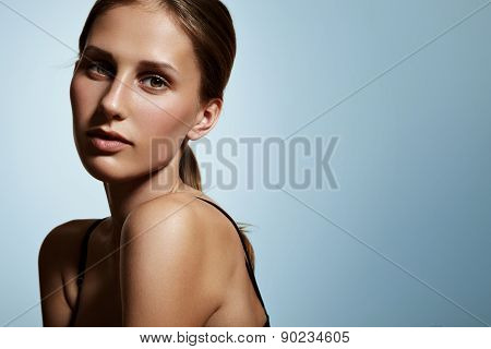 Young Woman With Ideal Skin On A Blue