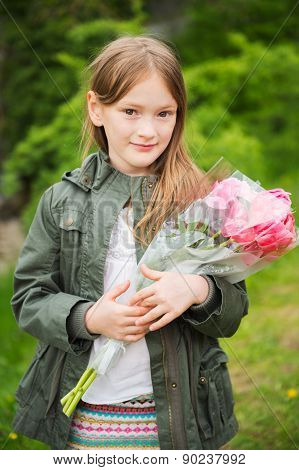 Outdoor portrait of a cute little girl