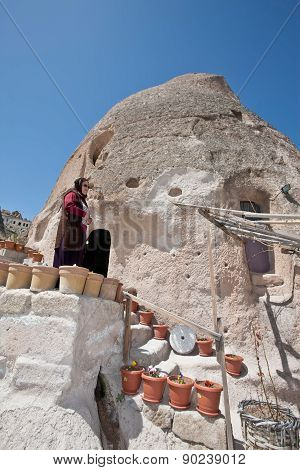 Turkish Woman At Her Cave Home In Cappadocia