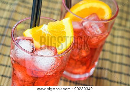 Two Glasses Of Spritz Aperitif Aperol Cocktail With Two Orange Slices And Ice Cubes