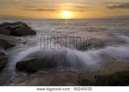 Sunset Ocean Beach Wave Breaking On Rocks
