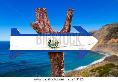 El Salvador Flag wooden sign with coast background