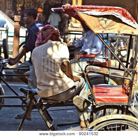 Man Rests In His Cycle Rickshaw