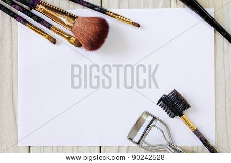 Foundation And Brushes On The White Wood And Paper Background
