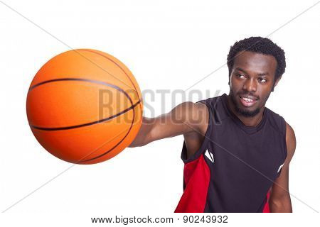 Basketball player holding a basketball, isolated on white background