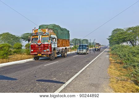 People In Overloaded Cars On The Highway Between Delhi And Agra