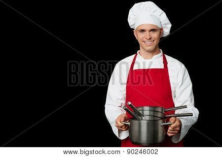 Young Chef Holding Empty Vessels In Hands