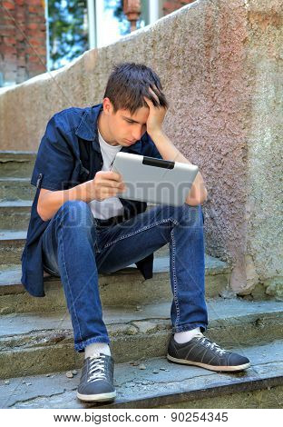 Sad Teenager With Tablet Computer
