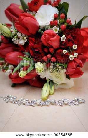 Beautiful Wedding Bouquet And Necklace On The Table
