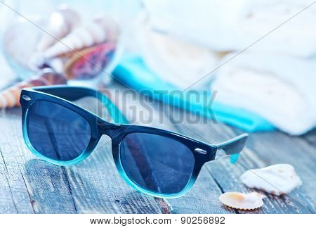 Sun Glasses And Flip Flops