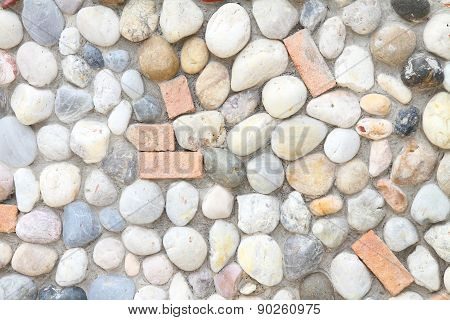 Stone in cement wall