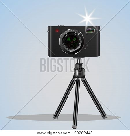 Abstract Digital Photo Camera On Small Tripod.