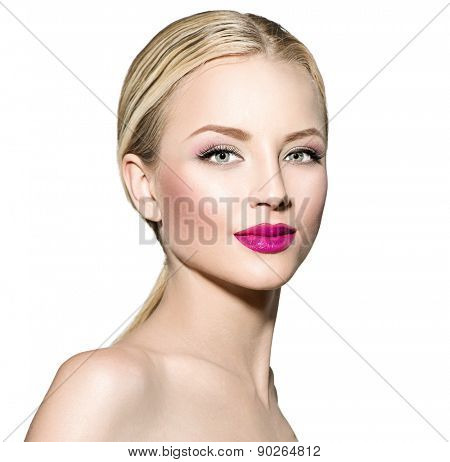 Beautiful fashion model girl with blond straight hair. Portrait of glamour woman with bright makeup isolated on white background. Beauty female face close up with perfect make up