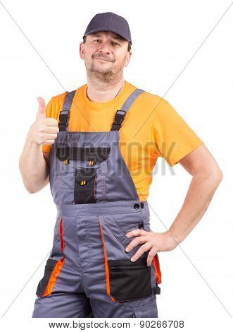 Happy worker wearing overalls.