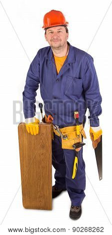 Worker with saw in hand.