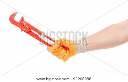 Hand in gloves holding gas wrench.